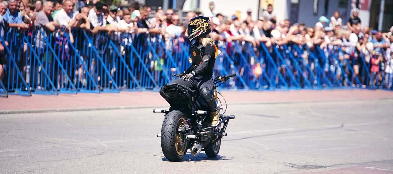 Ewa Stunts Riding Motorcycle Backwards